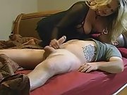 Huge-boobed cougar surprises a kinky stud while her husband is away