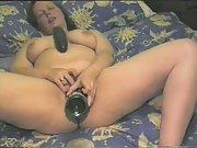 A bottle and a cucumber bring on an orgasm